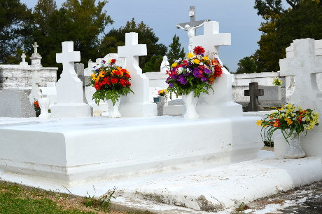 Silk and plastic flowers on tombs in St. Eloi