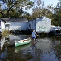 Bayou Woman walks through hurricane flood waters