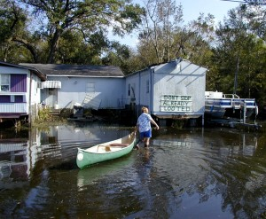 Bayou Woman walks through hurricane flood waters