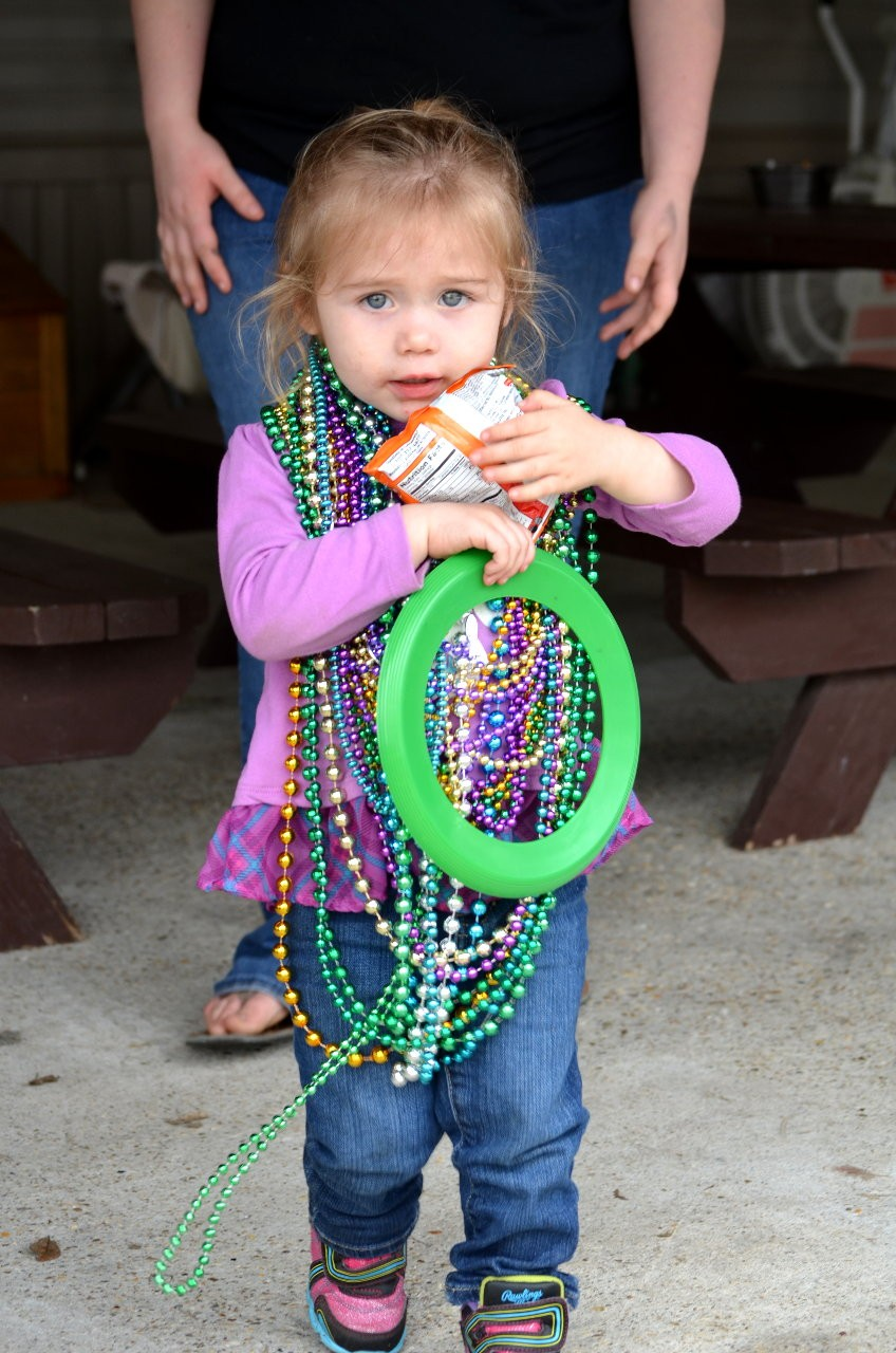 This little darling caught her fair share of beads!