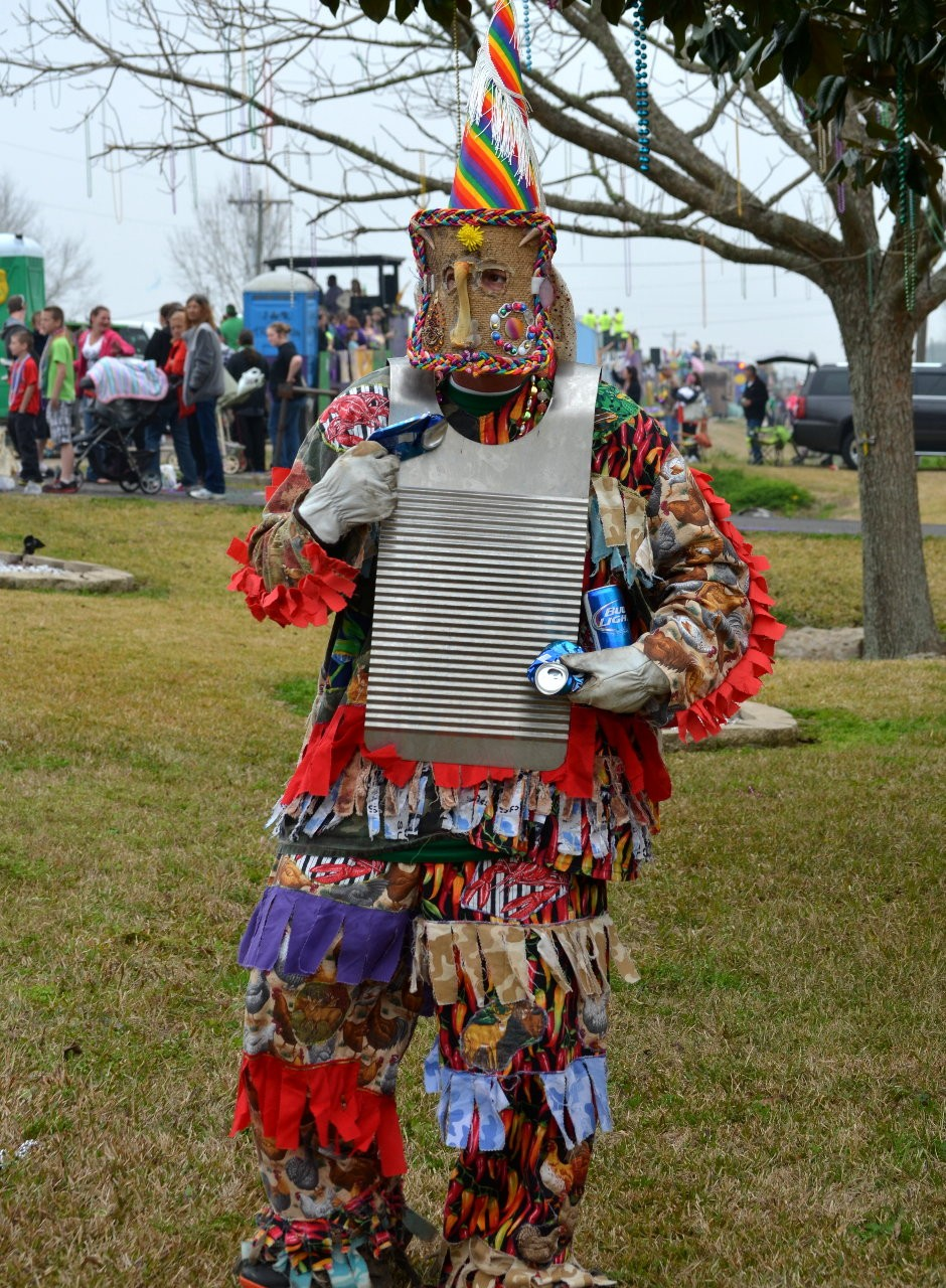 Runner playing washboard with crushed beer cans!  How original!