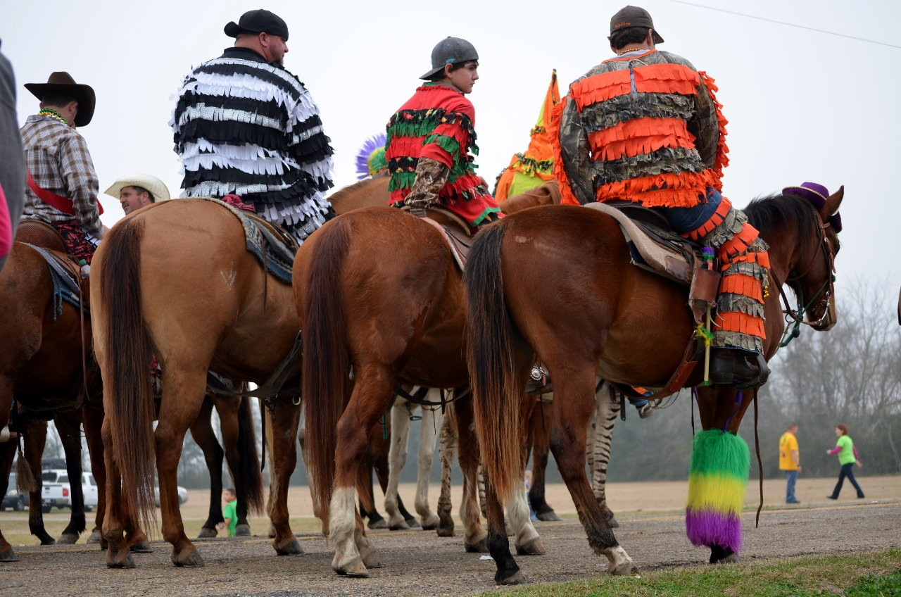 These Mardi Gras Runners on horseback reminded me of prisoner costumes, for some reason!
